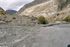 KKH near the Chinese border, crumbling under the onslaught of glacier water and rock slides