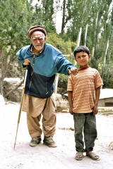 An old (centagenarian ?) Hunza man with his great great grandson